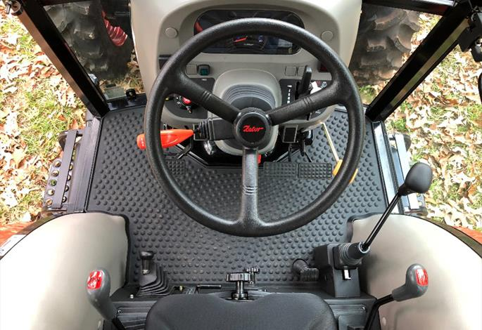 M70PSC Cab layout and Dash Panel. Power Shuttle lever, Factory Joystick Control, 3-range shift lever, 4-speed transmission shifter, PTO speed selector, mechanical seat weight adjustment and more.